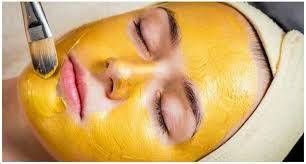 đắp mặt nạ tinh bột nghệ trị mụn